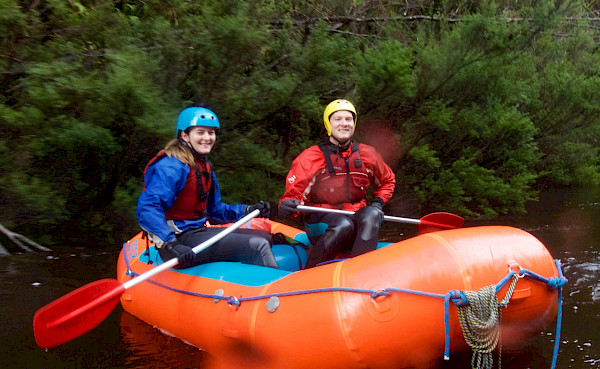 Two whitewater rafters on a river