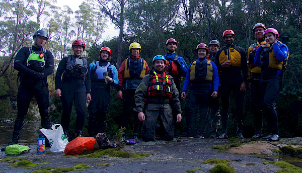 Group of people wearing whitewater rafting gear