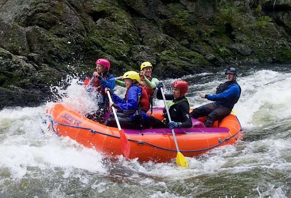 Whitewater raft going through rapid