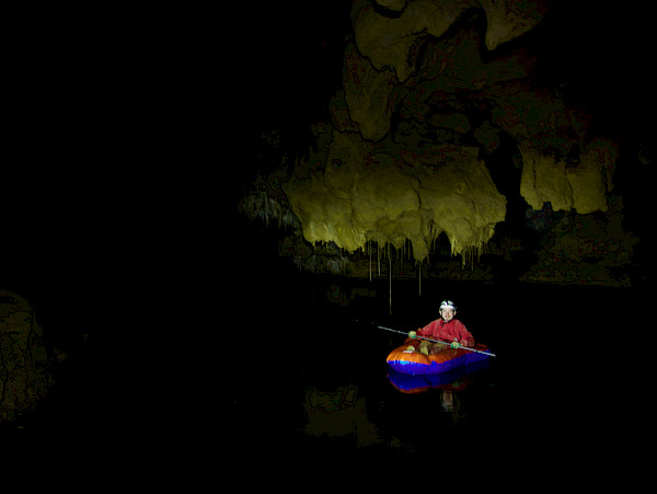 Author in a raft on an underground lake