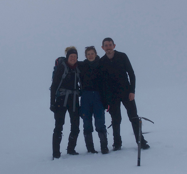 Walkers at top of mountain in poor visibility