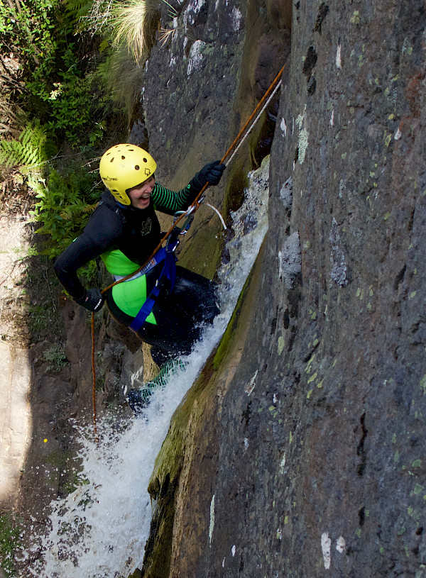 Person abseiling in a waterfall
