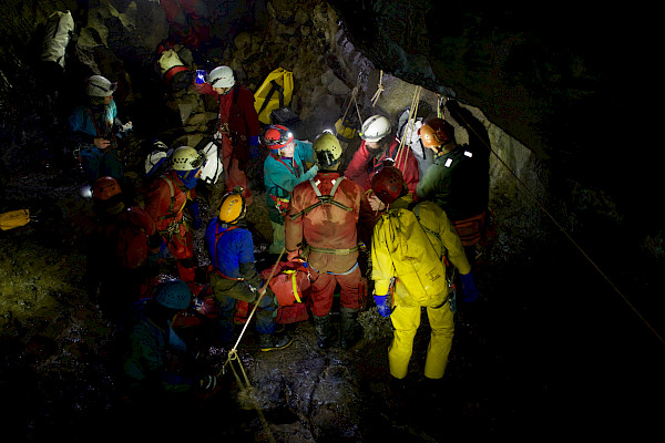 Group of cavers in the cave