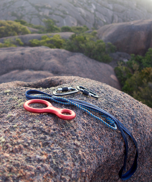 Climbing gear sitting on a rock